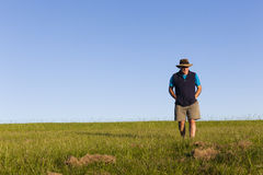 Man Walking Grass Field Royalty Free Stock Photo