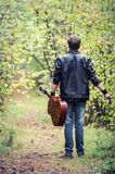 Man walking with guitar  Royalty Free Stock Image
