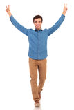 Man walking with hands up in the air making victory Stock Photos