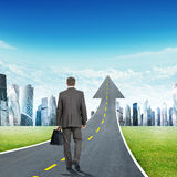 Man walking on highway going up as arrow Stock Photography