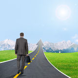 Man walking on highway road going up as an arrow Stock Photos