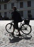 Man walking his bicycle Royalty Free Stock Photos