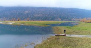 Man walking with his dog near lakeside 4k. Man walking with his dog near lakeside at countryside 4k stock video footage