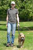 Man walking with his dog Stock Photography
