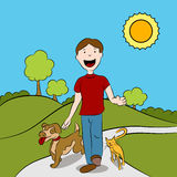 Man Walking With His Pets in The Park Stock Photos