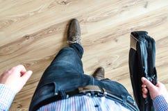 Man Walking Holding Leather Bag Stock Photography
