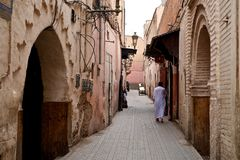 man walking home in the old town part of the city stock photography