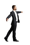 Man walking on invisible rope Royalty Free Stock Image