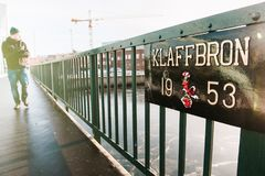 Man walking on the Klaffbron the new flap bridge drawbridge. MALMO, SWEDEN - DEC 29, 2018: Adult man walking on the Klaffbron the new flap bridge drawbridge Stock Photography