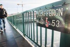 Man walking on the Klaffbron the new flap bridge drawbridge. MALMO, SWEDEN - DEC 29, 2018: Klaffbron the new flap bridge drawbridge bascule bridge in Malmo Stock Photos