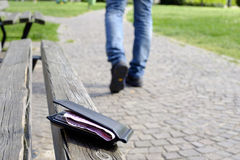 Man walking after losing his wallet Stock Image