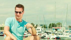 Man walking on marina during summer royalty free stock photos