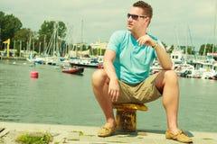 Man walking on marina during summer Stock Image