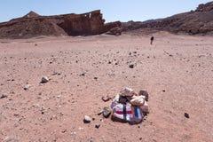 Man walking marked desert trail footpath. Royalty Free Stock Photos