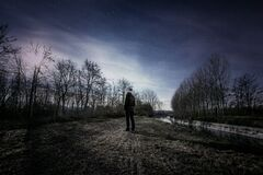Man walking in moonlight Stock Photo