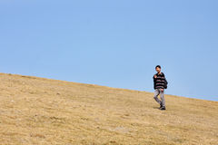 Man walking on the mountain Stock Photography
