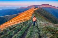 A man walking in the mountain stock image