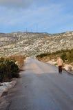 Man walking mountain road Stock Image
