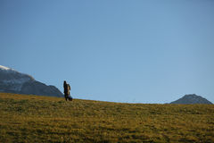 Man walking on the mountain Stock Photo