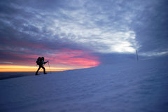 Man walking in the mountains by sunset Stock Image