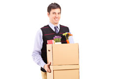Man walking with moving boxes Stock Photos