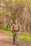 Man walking in nature with backpack - Portrait Royalty Free Stock Image