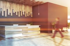 Man walking near gray reception desk royalty free stock images