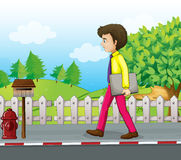 A man walking near the mailbox with a binder in his hand. Illustration of a man walking near the mailbox with a binder in his hand Stock Images