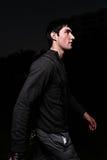 Man walking at night Stock Photos