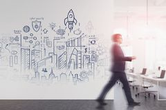 Man walking in office with start up sketch royalty free stock photography