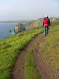 Man Walking On A Coastal Hiking Path, South England Stock Photo