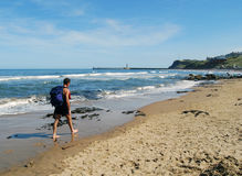 Man Walking On Beach Stock Photography