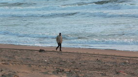 Free Man Walking On The Beach Stock Images - 37960024