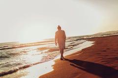 Free Man Walking On The Beach On Sunset. Royalty Free Stock Photo - 126197705
