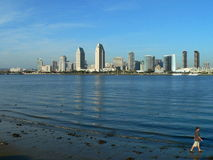 Man walking out of picture. Man walking out of the picture perfect San Diego Downtown, picture taken from Coronado Island on a sunny day Stock Images