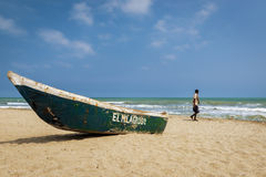 Man walking in the Palomino Beach in the Caribbean Coast of Colombia. Palomino, Colombia - March 13, 2014: Man walking in the Palomino Beach in the Caribbean Stock Image