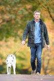 Man Walking Through Park Listening to MP3 Player Royalty Free Stock Image