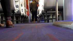 Man walking in the passenger train car stock footage