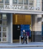 Man walking past the Sydney Exchange Square Stock Images