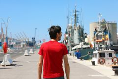 Man walking in the port harbor of Malaga, Spain stock photography