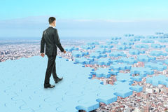 Man walking on puzzle road. Man walking on abstract blue puzzle piece road. White background. Success concept. 3D Rendering Royalty Free Stock Images