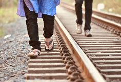 Man walking on the rail tracks isolated unique photograph stock image
