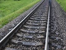 Man is walking on railroad rail. Visible his feet stock video