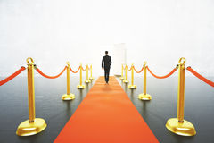 Man walking on red carpet concept Royalty Free Stock Photo