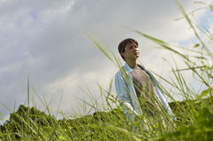 Man walking in reeds in morning Stock Images