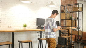 Man Walking Relax and Using Tablet pc in Office for work. +++ , creative designer , , creative designer , young man , freelancer stock footage