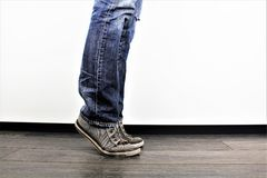 Man walking from right to left, casual clothing, people shot in indoors studio. Man walking from right to left, casual clothing, people shot in indoors Studio Royalty Free Stock Photos