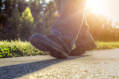 Man walking on road. Close up of a man walking on road royalty free stock images
