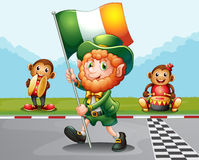 A man walking at the road holding the flag of Ireland Stock Photos
