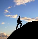 Man walking on rock Royalty Free Stock Image